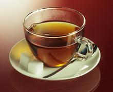 A cup of tea with sugar cubes Stock Photos