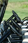 inside view of a row of golf carts - stock photo