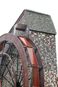 isolated giant water wheel for a old mill - stock photo