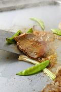 Beef Teppanyaki with mangetout (fried) - stock photo