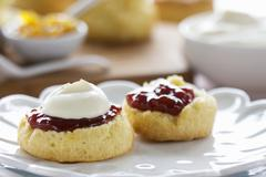 Scones with cream and jam Stock Photos