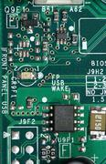 computer chip and circuit board - stock photo