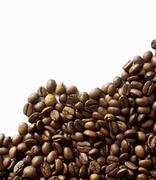 Coffee beans against white background - stock photo