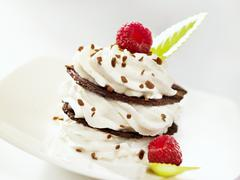 Chocolate wafer and cream fancy garnished with raspberries - stock photo
