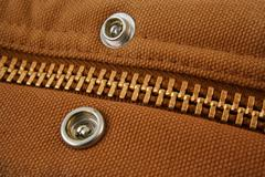Large gold zipper macro with snaps Stock Photos