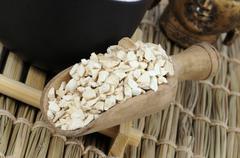 Angelica root (Angelica dahurica) in a wooden scoop Stock Photos