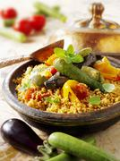 Couscous with fried vegetables - stock photo