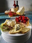Blue cheese, crackers and pie - stock photo