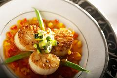 Seared Sea Scallops with Green Beans and Orange Sauce - stock photo