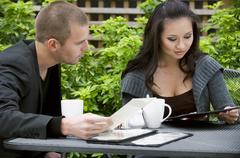 Young woman and man reading the menu - stock photo