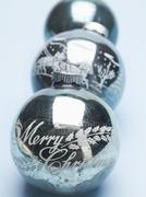 Antique silver Christmas baubles in a row - stock photo