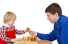 man give child chess-man - stock photo