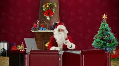 Santa Claus talking in a Christmas Room, time-lapse Stock Footage