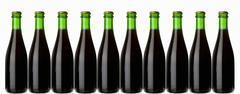 Ten green bottles standing in a row (stout, dark beer) Stock Photos