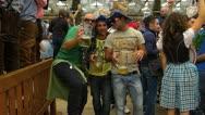 Oktoberfest Germany Munich Beer Festival Beer tent visitor enjoying Stock Footage