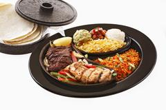 Chicken and beef fajita with accompaniments and tortillas Stock Photos