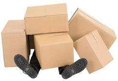 Male feet under a heap of boxes Stock Photos