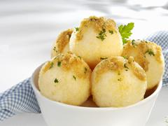 Potato dumplings with buttered breadcrumbs and parsley Stock Photos