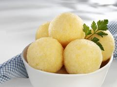 Several potato dumplings in bowl Stock Photos
