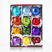 Several shiny, coloured Christmas baubles in box Stock Photos