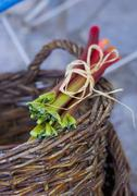 A bundle of rhubarb on a basket Stock Photos