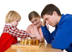 man and child play chess - stock photo