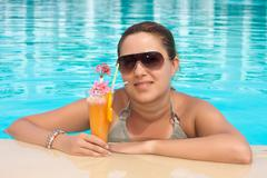 happiness young woman enjoy in cocktail on the pool with  - stock photo
