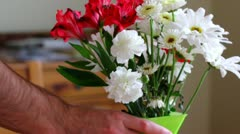 man romoves flower bouquet and the replaces it - stock footage