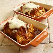 Rolled Cheese Lasagna with Marinara Sauce and Melted Mozzarella in Casserole Stock Photos