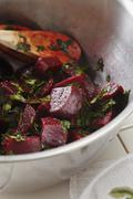 Fresh Beet Salad with Parsley and Lemon in a Metal Bowl - stock photo