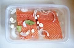Marinating salmon - stock photo