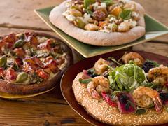 Three Assorted Artisan Pizzas Stock Photos