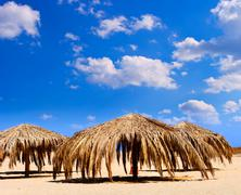 Sunshade on tropical beach Stock Photos