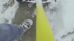 Snow shovel on home sidewalk point of view HD 003 Stock Footage