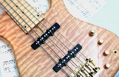 Bass guitar on notes - angle Stock Photos