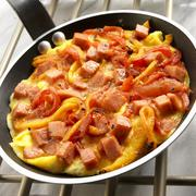Piperrada (Basque Pepper Omelet) in a Skillet - stock photo