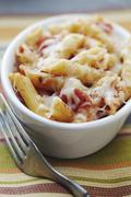 Individual Baked Penne with Tomatoes and Cheese; Fork - stock photo