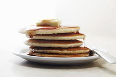 Stock Photo of Pile of pancakes with maple syrup and butter