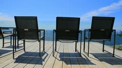 Three Patio Chairs Stock Footage
