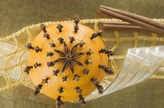An orange pierced with cloves and an anise star Stock Photos