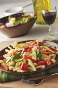 Pasta Primavera with Zucchini, Carrots, Red Pepper, Tomatoes, Basil and Grated Stock Photos