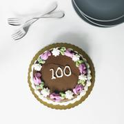 Chocolate Frosted Birthday Cake with the Number 100 On It; From Above - stock photo