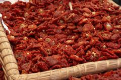 A basket of dried tomatoes Stock Photos