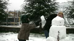 Mother and son with snowman Stock Footage