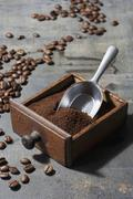 Ground coffee beans in a drawer belonging to an old coffee mill Stock Photos
