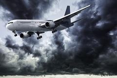 Jet in a dark stormy sky Stock Photos