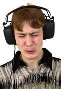 Nuori mies kuulokkeet Kuvituskuvat