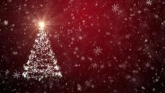 Christmas tree with falling snowflakes and stars Stock Footage