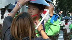 Young Japanese boy with conical hat and flute during the Nagoya Matsuri - stock footage