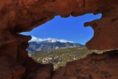 Pikes Peak Through Rock Window - stock photo